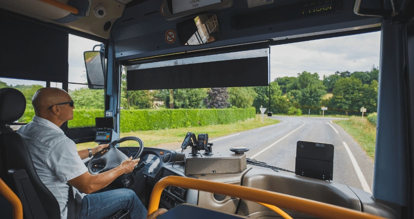 Theme Is The Profession Of The Driver And Passenger Transportation. A Man In Sunglasses A Driver Drives A Tourist Regional Bus In The France Region Of The Burgundy In Summer