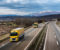 Fleet Of Yellow Trucks In Line As A Convoy At A Rural Countryside